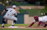STANFORD, CA - March 25, 2011: Austin Wilson of Stanford baseball dives back on a pickoff attempt during Stanford's game against Long Beach State at Sunken Diamond. Stanford lost 6-3.