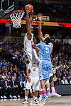 Greg McClinton (11) of the Wake Forest Demon Deacons flies to the basket past Marcus Paige (5) of the North Carolina Tar Heels during first half action at the LJVM Coliseum on January 21, 2015 in Winston-Salem, North Carolina.  The Tar Heels defeated the Demon Deacons 87-71.  (Brian Westerholt/Sports On Film)
