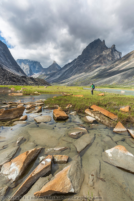 Hiker in the Arrigetch Creek valley in the Arrigetch Peaks, Gates of the Arctic National Park, Alaska