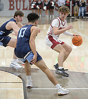 Springdale's JP Hignite (right) looks to drive to the lane Saturday, Feb. 8, 2020, as Har-Ber's Nick Buchanan (13) and Charlie Bockelman defend during the first half of play in Bulldog Arena in Springdale. Visit nwaonline.com/prepbball/ for a gallery from the games.<br /> (NWA Democrat-Gazette/Andy Shupe)