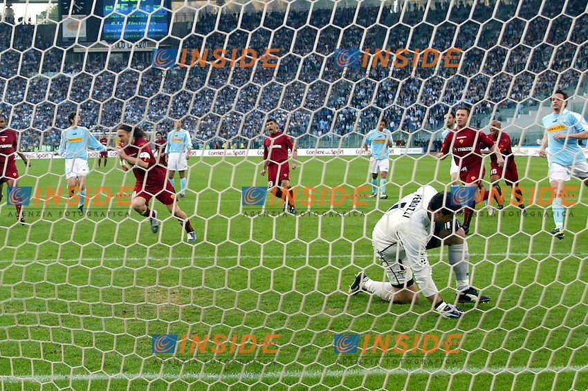 Roma 21/4/2004 Campionato Italiano Serie A <br /> Lazio - Roma 1-1 <br /> Francesco Totti festeggia il gol con Peruzzi battuto<br /> Francesco Totti celebrates after equalizing by a penalty kick during the Italian Major League soccer match against Lazio at Rome's Olympic stadium, Wednesday, April 21, 2004. Lazio and Roma are playing again after it was suspended on March 21, 2004, for security reasonsFoto Andrea Staccioli Insidefoto