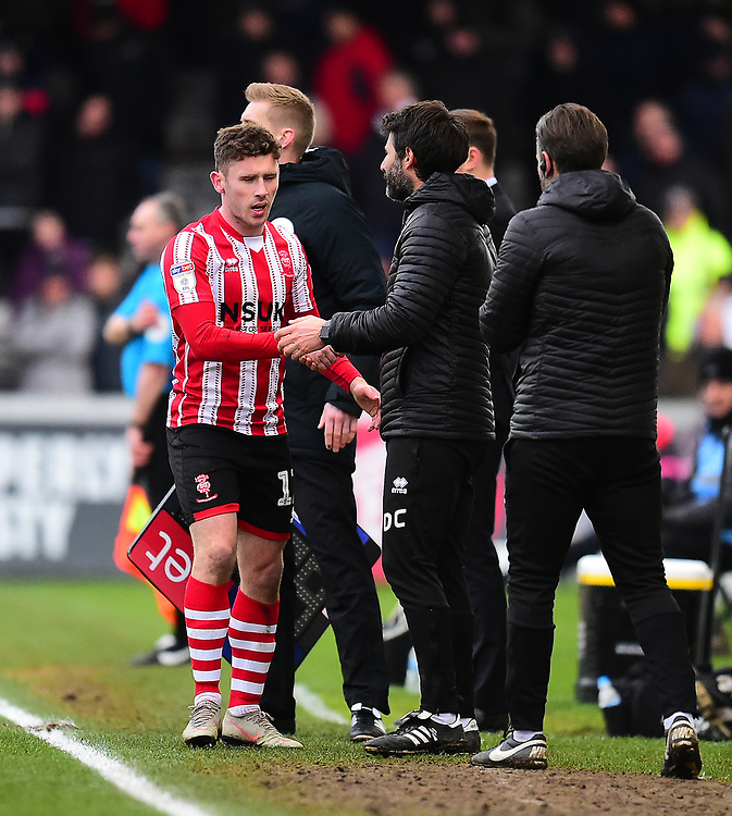 Lincoln City's Shay McCartan, left, shakes hands with Lincoln City manager Danny Cowley<br /> <br /> Photographer Andrew Vaughan/CameraSport<br /> <br /> The EFL Sky Bet League Two - Lincoln City v Grimsby Town - Saturday 19 January 2019 - Sincil Bank - Lincoln<br /> <br /> World Copyright &copy; 2019 CameraSport. All rights reserved. 43 Linden Ave. Countesthorpe. Leicester. England. LE8 5PG - Tel: +44 (0) 116 277 4147 - admin@camerasport.com - www.camerasport.com