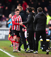 Lincoln City's Shay McCartan, left, shakes hands with Lincoln City manager Danny Cowley<br /> <br /> Photographer Andrew Vaughan/CameraSport<br /> <br /> The EFL Sky Bet League Two - Lincoln City v Grimsby Town - Saturday 19 January 2019 - Sincil Bank - Lincoln<br /> <br /> World Copyright © 2019 CameraSport. All rights reserved. 43 Linden Ave. Countesthorpe. Leicester. England. LE8 5PG - Tel: +44 (0) 116 277 4147 - admin@camerasport.com - www.camerasport.com