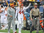 Morgantown, WV - November 18, 2017: Texas Longhorns linebacker Breckyn Hager (44) gets escorted after being thrown out of he game between Texas and WVU at  Mountaineer Field at Milan Puskar Stadium in Morgantown, WV.  (Photo by Elliott Brown/Media Images International)