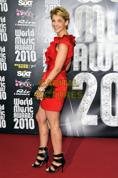 CLOTILDE COURAU.World Music Awards 2010 at the Sporting Club Monte Carlo, Monaco..18th May 2010 .full length red ruffle sleeveless dress black straps sandals clutch bag side.CAP/PL.©Phil Loftus/Capital Pictures.