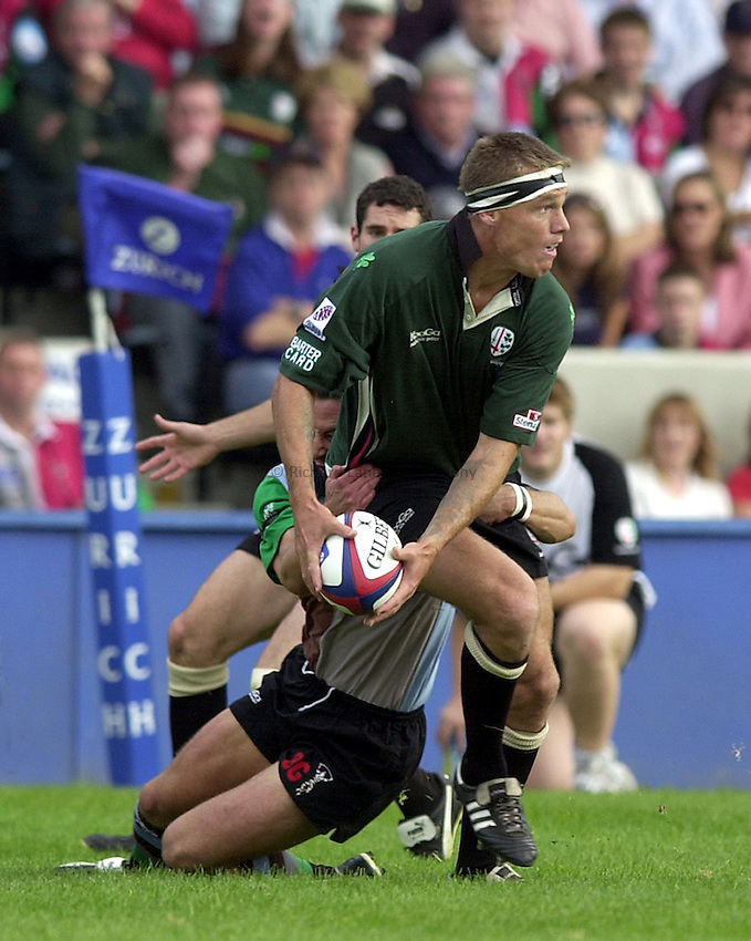 Photo. Richard Lane.NEC Harlequins v London Irish. Zurich Premiership. 21-09-2002.Michael Horack gets the ball away in the tackle.