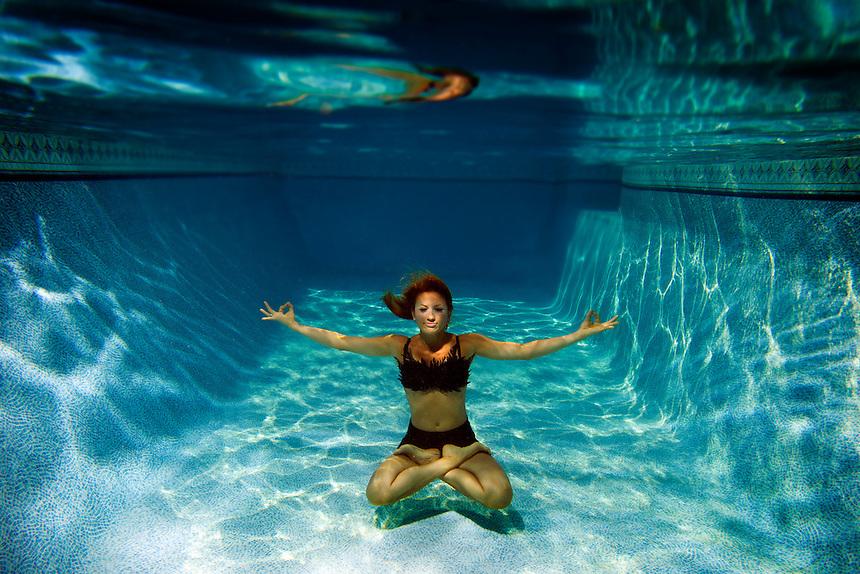 Photo by K.C. Alfred c 2013 A female underwater fashion model.