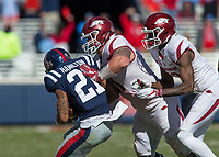 Hawgs Illustrated/BEN GOFF <br /> Jordan Jones (right), Arkansas wide receiver, looks on as Hjalte Froholdt, Arkansas left guard, tackles Javien Hamilton, Ole Miss cornerback, after Hamilton intercepted an Arkansas pass in the fourth quarter Saturday, Oct. 28, 2017, at Vaught-Hemingway Stadium in Oxford, Miss.