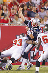 New England Patriots quarterback Tom Brady (12) gets the pass away as Tampa Bay Buccaneers defensive tackle Gerald McCoy (93) brings him down in a preseason game between the Buccaneers and the Patriots Thursday, August 18, 2011 in Tampa, Fla.  (AP Photo/Margaret Bowles)
