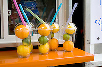 Fruit juice stand display of lemons limes and orange drink ingredients. Grand Old Day Street Fair St Paul Minnesota USA