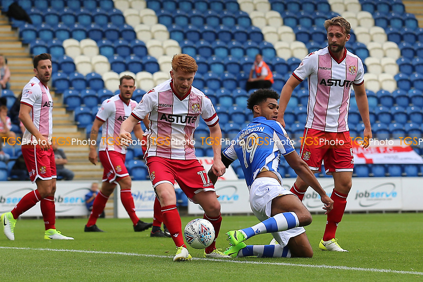 Dale Gorman of Stevenage and Mikael Mandron of Colchester United during Colchester United vs Stevenage, Sky Bet EFL League 2 Football at the Weston Homes Community Stadium on 12th August 2017