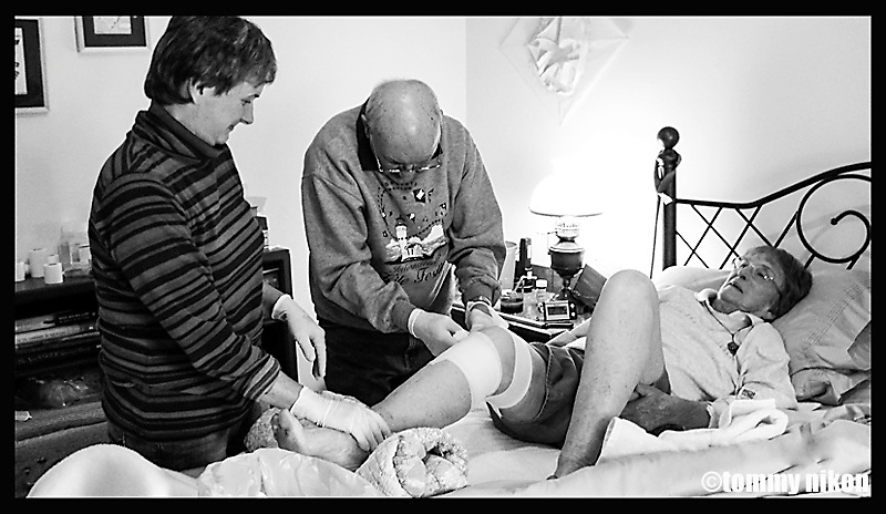 Change of leg dressings by family members;Mom getting her dressings changed by dad and my sister.<br />