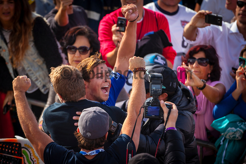 SUPERTUBOS, Peniche/Portugal (Friday, October 19, 2012) - Julian Wilson (AUS), 23, has claimed his maiden ASP World Championship Tour (WCT) victory today, besting a rampaging Gabriel Medina (BRA), 18, in the dying seconds of the Rip Curl Pro Portugal...Stop No. 8 of 10 on the 2012 ASP World Championship Tour, the Rip Curl Pro Portugal played host to pivotal moments in the hunt for the 2012 ASP World Title as well as today's dramatic culmination between two rising superstars...In a replay of the surfers' Final match-up from France last season, Medina and Wilson went blow-for-blow in today's Final in front of a capacity crowd at Supertubos. While Medina favored a more technical approach to the heat, executing a number of progressive maneuvers, it was Wilson's barrel sense and combination ability that ultimately tipped the heat in the final moments...?I'm overwhelmed,? Wilson said. ?I lost to Gabriel (Medina) on the buzzer last year in France and to beat him back again on the buzzer, I don't even know how to describe the feeling. He was trying to hold onto the lead in the end there, he pretty much did what I did in the Final last year in France. He was too busy worrying about me, and that wave came in the dying moments and that was the scorer. I don't know what to say, I'm just so happy.?..Wilson's final wave, a multi-section barrel followed by a number of turns, came in at an 8.43 and gave the Australian the edge with no time left on the clock. Both surfers arrived to the shoreline without knowing who had won the Final. Photo: joliphotos.com