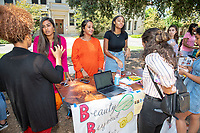 Occidental College students browse the tables at the Involvement Fair in the Academic Quad, Sept. 6, 2018. The annual event is an opportunity for students to learn about and join student-run clubs that offer a wide variety of interests.<br /> (Photo by Marc Campos, Occidental College Photographer)