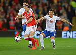Gareth Bale of Wales is challenged by Dusan Tadic of Serbia during the FIFA World Cup Qualifying match at the Cardiff City Stadium, Cardiff. Picture date: November 12th, 2016. Pic Robin Parker/Sportimage