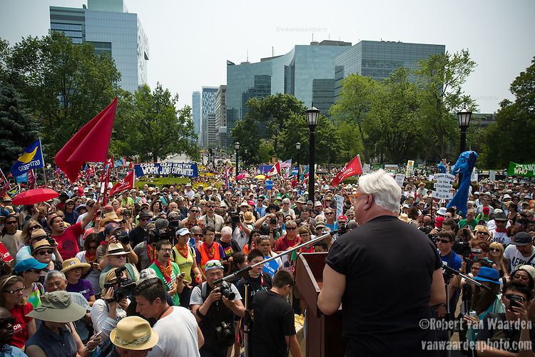 Fred Hahn from CUPE Ontario speaks to the crowd before the march for Jobs, Justice and the Climate. <br /> <br /> On July 5th more than 10,000 people gathered in Toronto, the traditional territories of the Missisauga peoples, for the March for Jobs, Justice and the Climate. The march told the story of a new economy that works for people and the planet. People marched for an economy that starts with justice, creates good work, clean jobs and healthy communities. The people recognize that we have solutions and we know who is responsible for causing the climate crisis. (Photo: Robert van Waarden