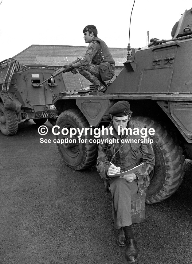 Major Chris Miers, the British Army's official war artist, at work in Belfast,  during the N Ireland Troubles. Whilst be sketches a bodyguard remains vigilant. Major Miers is serving with the Royal Green Jackets. 197211200731c.<br /> <br /> Copyright Image from Victor Patterson, 54 Dorchester Park, Belfast, UK, BT9 6RJ<br /> <br /> t1: +44 28 9066 1296 (from Rep of Ireland 048 9066 1296)<br /> t2: +44 28 9002 2446 (from Rep of Ireland 048 9002 2446)<br /> m: +44 7802 353836<br /> <br /> e1: victorpatterson@me.com<br /> e2: victorpatterson@gmail.com<br /> <br /> The use of my copyright images is subject to my Terms &amp; Conditions.<br /> <br /> It is IMPORTANT that you familiarise yourself with them. They are available on my website at www.victorpatterson.com.<br /> <br /> None of my copyright images may be used on a website unless they are visibly watermarked, i.e. &copy; Victor Patterson within the body of the visible image. Metadata denoting my copyright must NOT be deleted. <br /> <br /> Web use is extra at currently recommended NUJ rates.