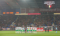 The teams show their respects to those in Belgium ahead of the International Friendly match between Wales and Northern Ireland at Cardiff City Stadium, Cardiff, Wales on 24 March 2016. Photo by Mark  Hawkins / PRiME Media Images.
