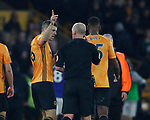 Conor Coady of Wolverhampton Wanderers enquires to referee Mike Dean as to why VAR ruled out a goal during the Premier League match at Molineux, Wolverhampton. Picture date: 14th February 2020. Picture credit should read: Darren Staples/Sportimage