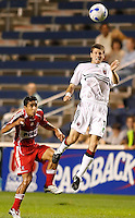 DC United midfielder Joshua Gros (17) heads the ball as Chicago Fire midfielder Ivan Guerrero (23) looks on.  The Chicago Fire defeated the DC United 3-0 in the semifinals of the U.S. Open Cup at Toyota Park in Bridgeview, IL on September 6, 2006...