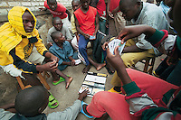 Rwanda. Southern province. District of Muhanga. Central jail of Gitarama. A group of black boys play cards. Minors block. Minors in detention. Detention pending trial and after trial, when sentenced to prison. The non-governmental organization (NGO) Fondation DiDé - Dignité en détention runs the Encademi (Encadrement des mineurs) program. Prison centrale de Gitarama. Quartier des mineurs.  © 2007 Didier Ruef