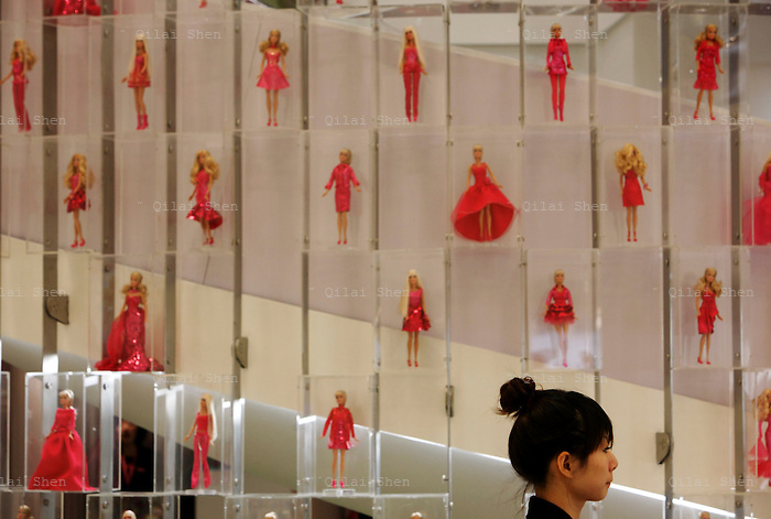 An employees stands in attendance during the Media Sneak Preview of the new Barbie Shanghai flagship store in Shanghai, China on 20 February 2009.  The Barbie store has become a hit in Shanghai as a place where doting mothers take their daughters, often the only child in the family, for a girls' day out.