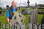 Billy Browne with a celtic Cross headstone that was broken during a spate of vandalism of Killorglin Graveyard on Thursday night.
