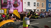 "Pictured: The ""Cool Runnings"" float in Aberaeron, west Wales, UK<br /> Re: Police are investigating a complaint after a carnival float was ""considered racist"" as it featured people who had painted their faces black.<br /> Aberaeron's bank holiday carnival had a float based on Jamaica's bobsleigh team from the film Cool Runnings.<br /> A Labour Party member in Ceredigion called the incident ""unacceptable"".<br /> Dyfed-Powys Police said it had received a report ""of a perceived hate incident"". Carnival organisers have been asked to comment.<br /> Dinah Mulholland, Labour's candidate for Ceredigion at June's General Election, said: ""There may have been no conscious agenda or racist intent towards involved people of African or Caribbean heritage in the Cool Runnings float."