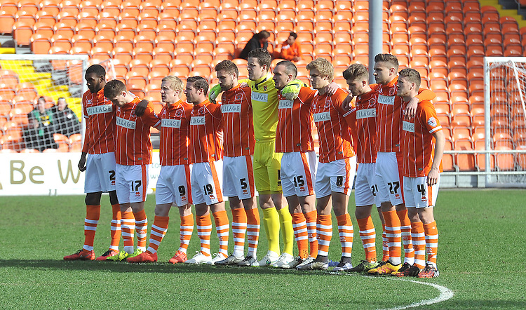 The Blackpool players observe the minutes silence in respect of the fallen in Belgum<br /> <br /> Photographer Dave Howarth/CameraSport<br /> <br /> Football - The Football League Sky Bet League One - Blackpool v Bury - Friday 25th March 2016 - Bloomfield Road - Blackpool    <br /> <br /> &copy; CameraSport - 43 Linden Ave. Countesthorpe. Leicester. England. LE8 5PG - Tel: +44 (0) 116 277 4147 - admin@camerasport.com - www.camerasport.com