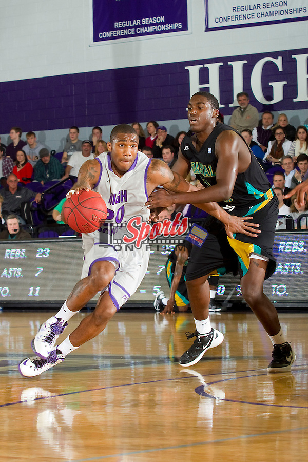 Corey Law (20) of the High Point Panthers drives past Tristian Curtis (21) of the Coastal Carolina Chanticleers during second half action at Millis Athletic Center on February 9, 2013 in High Point, North Carolina.  The Panthers defeated the Chanticleers 74-62.   (Brian Westerholt/Sports On Film)