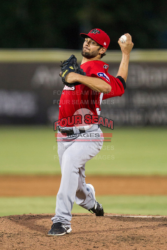 Frisco Roughriders pitcher Nick Martinez (31) delivers a pitch to the plate in the Texas League baseball game against the San Antonio Missions on August 22, 2013 at the Nelson Wolff Stadium in San Antonio, Texas. Frisco defeated San Antonio 2-1. (Andrew Woolley/Four Seam Images)