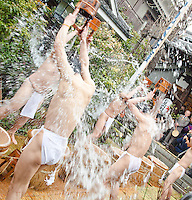 Trainee priest pour cold water over themselves on a cool winters day at Noseimiyokensan temple in Tokyo`s Sumida district.