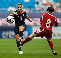 USWNT defender (3) Christie Rampone passes the ball upfield by Canada's (8) Diana Matheson during the finals of the Peace Queen Cup.  The USWNT defeated Canada, 1-0, at Suwon World Cup Stadium in Suwon, South Korea.