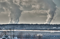 Huge clouds of steam rise from the Sarnia's industrial complex above the 1,000 acre solar farm.