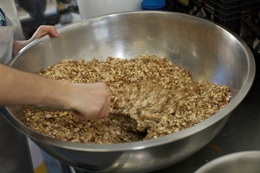 Granola Labs' Alex Crosler working on a new batch of granola....© Clay Williams / http://claywilliamsphoto.com