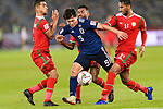 Minamino Takumi of Japan (C) is tackled by Mohammed Al Musallami (L), Harib Al Saadi (2nd R) and Khalid Al Braiki of Oman (R) during the AFC Asian Cup UAE 2019 Group F match between Oman (OMA) and Japan (JPN) at Zayed Sports City Stadium on 13 January 2019 in Abu Dhabi, United Arab Emirates. Photo by Marcio Rodrigo Machado / Power Sport Images