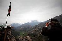 An ANA (Afghan National Army) soldier keeps guard at an outpost monitoring the restive Korengal Valley close to the Pakistan border in Kunar.