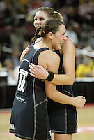 Silver Ferns Jodi Te Huna and Irene Van Dyk celebrate after the netball test match between the Silver Ferns v Australia played at the Sydney Superdome, Sydney Australia, 29th June 2005. The Silver Ferns won 50-43. ©Michael Bradley