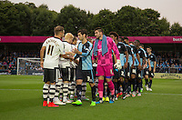 Captain Joe Jacobson of Wycombe Wanderers leads the handshakes during the Capital One Cup match between Wycombe Wanderers and Fulham at Adams Park, High Wycombe, England on 11 August 2015. Photo by Andy Rowland.
