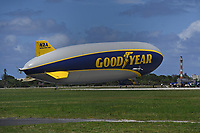 """POMPANO BEACH, FL - MAY 22: The Goodyear blimp """"Wingfoot One"""" lands at Pompano Beach Airfield after flying over South Florida hospitals on Friday to thank healthcare workers and first responders as Phase One opening begins In Broward county during the COVID-19 pandemic on May 22, 2020 in Pompano Beach, Florida. Credit: mpi04/MediaPunch"""