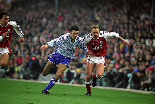 1 February 1992: United midfielder Ryan Giggs and Lee Dixon compete as they chase the ball during the Premiership match between Arsenal and Manchester United at Highbury. The match was draawn 1-1. Photo: Glyn Kirk/Actionplus..920201 man men football footballer soccer competing