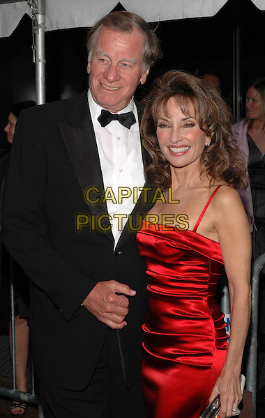 SUSAN LUCCI & GUEST.Arrive at the 2005 Daytime Emmys at Radio City Music Hall in New York City, USA, 20 May 2005..half length red dress.Ref: ADM.www.capitalpictures.com.sales@capitalpictures.com.©Patti Ouderkirk/AdMedia/Capital Pictures.