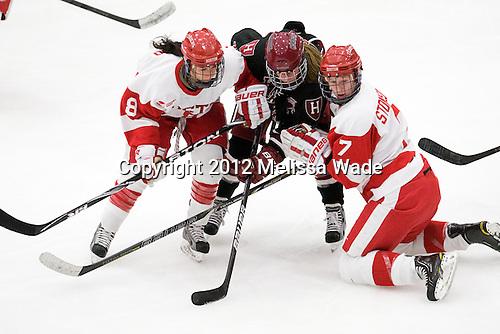 Kayla Tutino (BU - 8), Jillian Dempsey (Harvard - 14), Shannon Stoneburgh (BU - 7) - The Boston University Terriers defeated the visiting Harvard University Crimson 2-1 on Sunday, November 18, 2012, at Walter Brown Arena in Boston, Massachusetts.