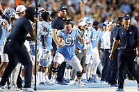 CHAPEL HILL, NC - SEPTEMBER 07: Wyatt Tunall #51 of the University of North Carolina encourages his teammates during a game between University of Miami and University of North Carolina at Kenan Memorial Stadium on September 07, 2019 in Chapel Hill, North Carolina.