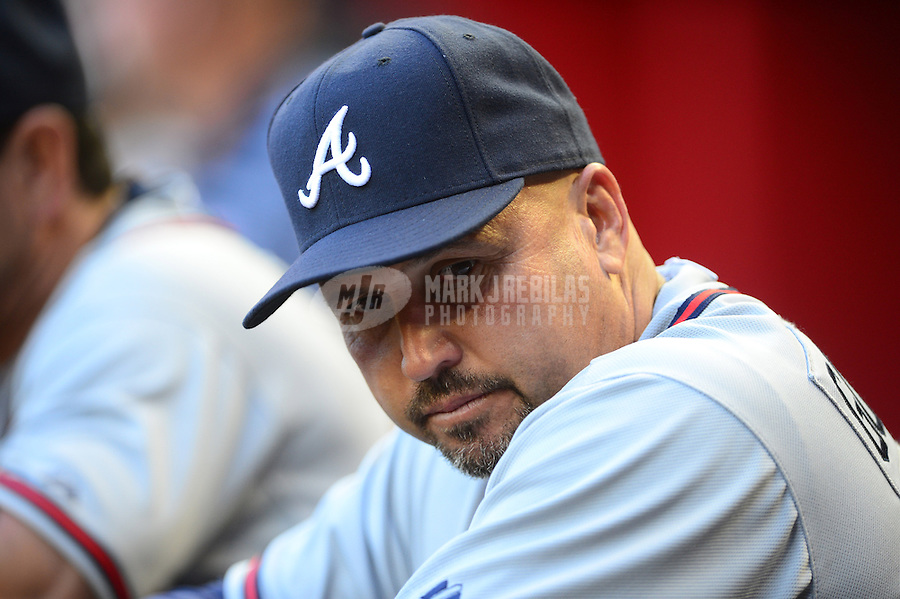 Apr. 21, 2012; Phoenix, AZ, USA; Atlanta Braves manager Fredi Gonzalez in the dugout in the second inning against the Arizona Diamondbacks at Chase Field.  Mandatory Credit: Mark J. Rebilas-