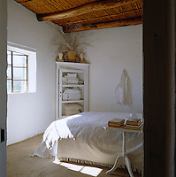 With its simple whitewashed walls, original reed ceiling and white bedlinen this bedroom is a haven of tranquility