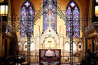 Doug Marshall plays the new digital organ after tuning and adding samples at St. Matthew's Church in Wheeling, West Virginia on August 3, 2015.  (Jared Wickerham for the Boston Globe)