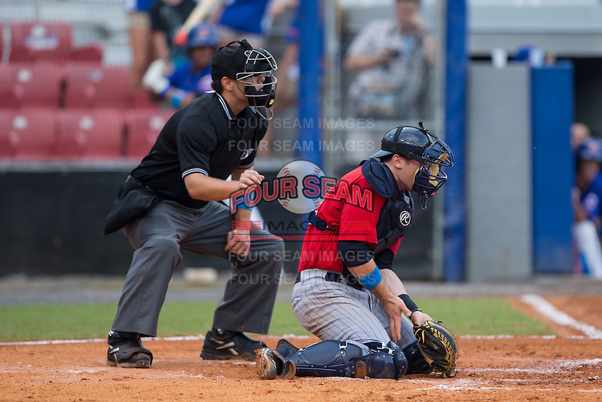 Elizabethton Twins catcher A.J. Murray (22) blocks a pitch in the dirt as home plate umpire Nick Susie looks on during the game against the Kingsport Mets at Hunter Wright Stadium on July 8, 2015 in Kingsport, Tennessee.  The Mets defeated the Twins 8-2. (Brian Westerholt/Four Seam Images)