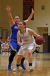 Thomaston, CT-121018MK06 Thomaston's Emily Root (21)  drives looks to pass as Gilbert's Jillian Wexler (1) defends Monday at Thomaston High School. Michael Kabelka / Republican-American