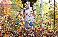 NWA Democrat-Gazette/DAVID GOTTSCHALK  Preston Watkins, with A Clean Cut LLC., uses a leaf blower to clear a lawn Wednesday, November 4, 2015, on Lafayette Street in Fayetteville. The business is a full service landscaping company based in Fayetteville.